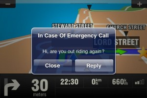 Image of iPhone message on the GPS Screen while motorcycling